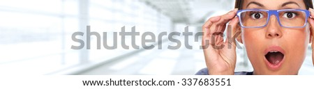 Beautiful woman eyes with eyeglasses. Optician banner background. - stock photo