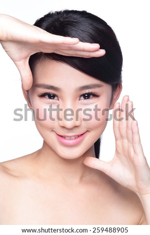 Beautiful Woman face and she making frame with hands with health skin, concept for skin care , asian beauty - stock photo