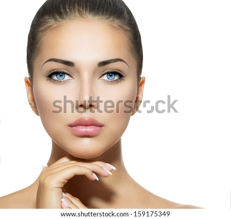 Beautiful Woman Face. Beauty Portrait. Beautiful Spa Woman Touching her Face. Perfect Fresh Skin. Pure Beauty Model Girl. Youth and Skin Care Concept. Brunette with Blue Eyes - stock photo