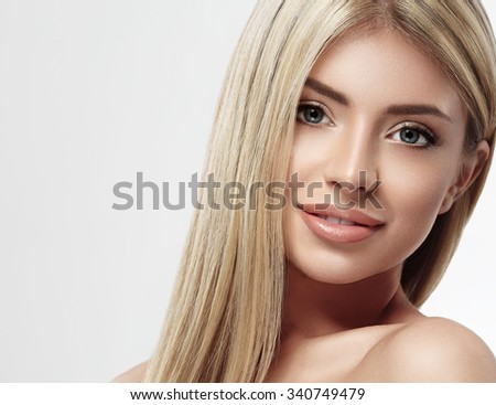 Beautiful woman face blonde hair portrait close up studio on white long hair