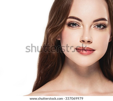 Beautiful woman face close up portrait young studio on white    - stock photo