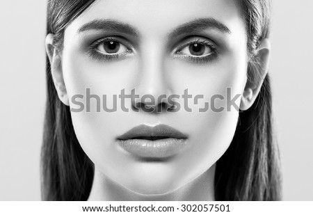 Beautiful woman face close up studio on white black and white