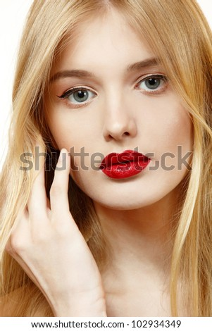 Beautiful woman face closeup with long blond hair and vivid red lipstick