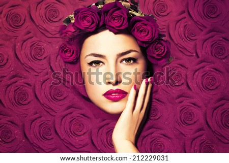 beautiful woman face framed with roses, flowers background - stock photo