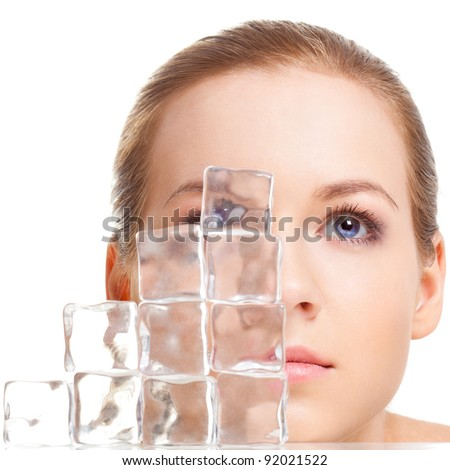 beautiful woman face near ice cubes over white background - stock photo