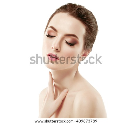 Beautiful woman face neck shoulders close up portrait young studio on white  - stock photo
