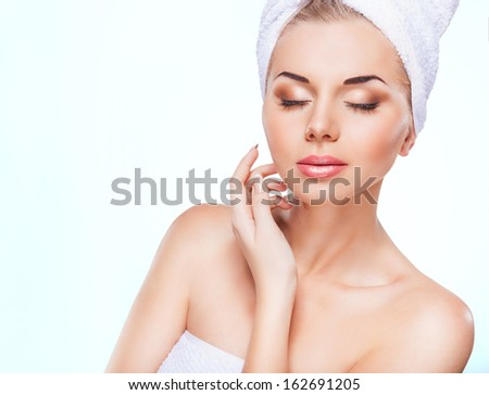 Beautiful woman face on white background - stock photo