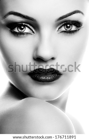Beautiful woman face. Perfect makeup. Beauty fashion .Close-up portrait of attractive young model with bright make-up.Photo has an intentional film grain) B&W.Fine art. - stock photo