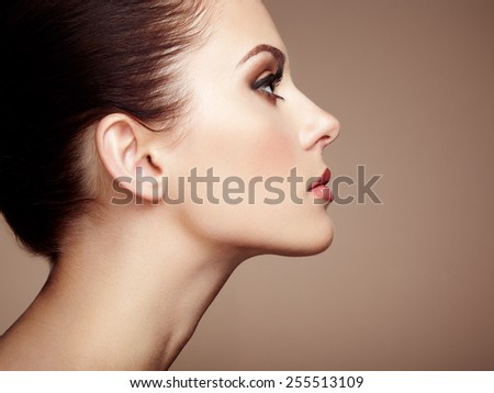 Beautiful woman face. Perfect makeup. Beauty fashion. Eyelashes. Cosmetic Eyeshadow - stock photo