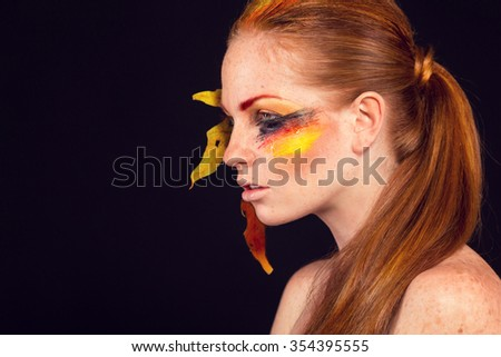 Beautiful woman face. Perfect makeup. Beauty fashion. Eyelashes. Cosmetic Eyeshadow. Concept of fall. the colors of the German flag - stock photo