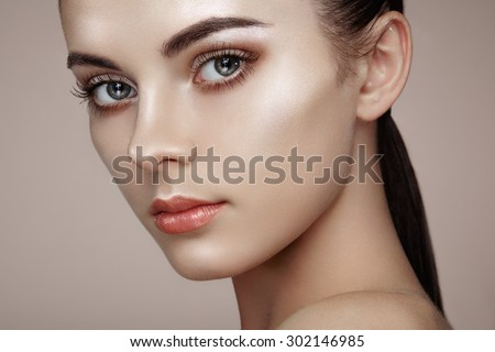 Beautiful woman face. Perfect makeup. Beauty fashion. Eyelashes. Cosmetic Eyeshadow. Highlighting - stock photo