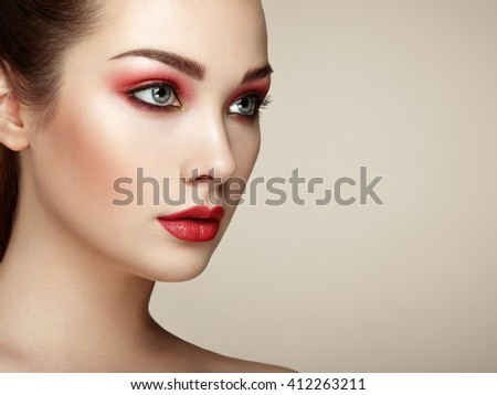 Beautiful woman face. Perfect makeup. Beauty fashion. Eyelashes. Lips. Cosmetic Eyeshadow. Perfect skin - stock photo