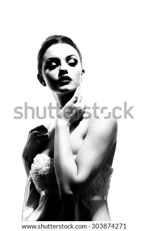 Beautiful woman face. Perfect makeup. Beauty fashion. Portrait of attractive young model with bright make-up. B&W. Fine art. - stock photo