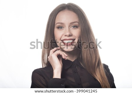 Beautiful woman face. Perfect toothy smile. Caucasian young girl close up portrait. red lips, skin, teeth. On white background. Studio shot . happy positive girl.  - stock photo
