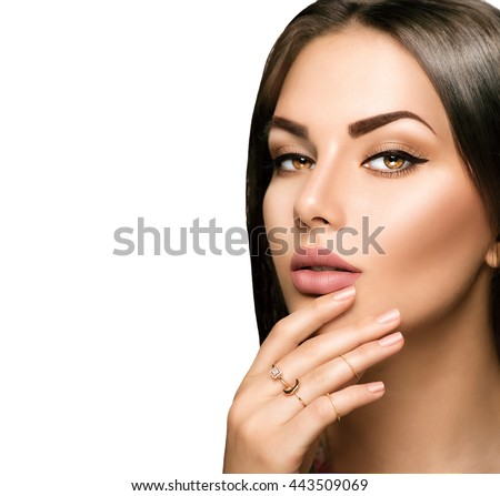 Beautiful woman face portrait close-up, perfect skin, hair and lips with beige matte lipstick makeup. Isolated on a white background  - stock photo