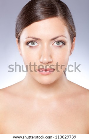beautiful woman face portrait over blue - stock photo