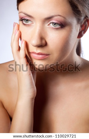 beautiful woman face portrait  with hand over blue - stock photo