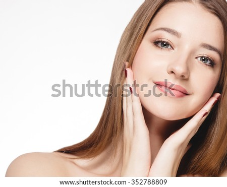 Beautiful woman face studio on white  - stock photo
