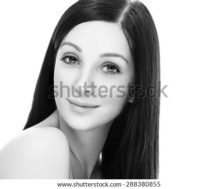 Beautiful woman face studio on white black and white long hair - stock photo