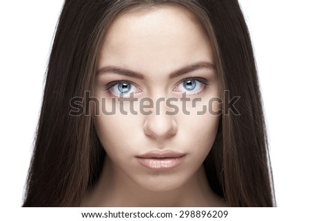 Beautiful woman face with blue eyes  closeup on white background - stock photo