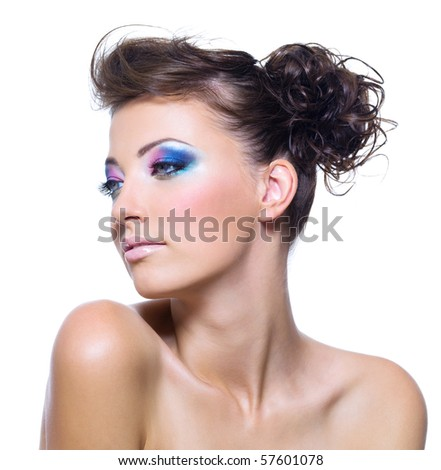 Beautiful woman face with bright make-up and creative hairstyle - stock photo