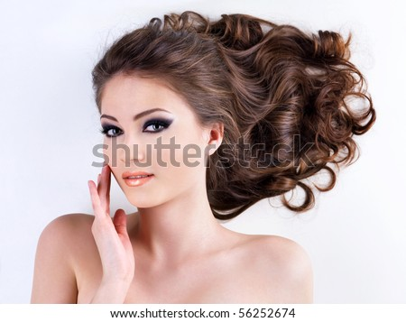 Beautiful  woman face with  clear healthy skin. High angle portrait - stock photo