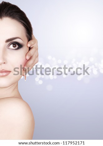 Beautiful woman face with fashion makeup  in cold tones - stock photo