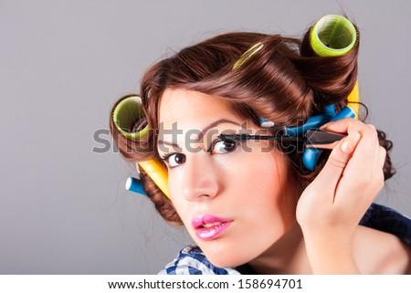 beautiful woman face with mascara brush - stock photo