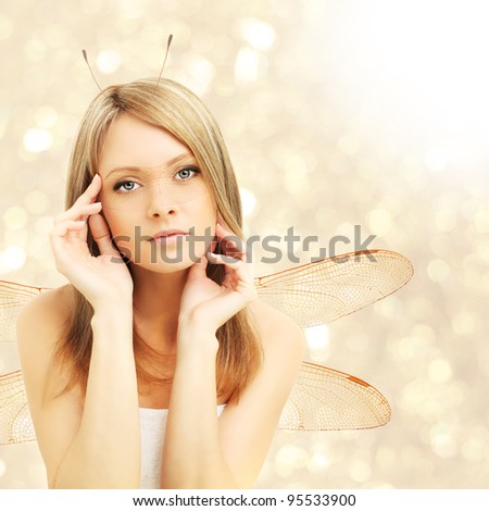 Beautiful woman - fantasy, abstract golden background - stock photo