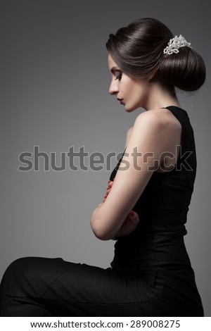 Beautiful Woman. Fashion Festive Coiffure with Pearls. Upsweep. Hairstyle. - stock photo