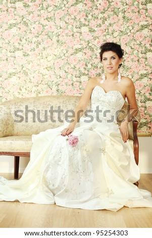 Beautiful woman fashion model in luxury interior - stock photo