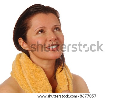 Beautiful woman feeling invigorated after a workout and shower - stock photo