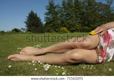 Beautiful Woman  feet  enjoying a sunny day outdoors