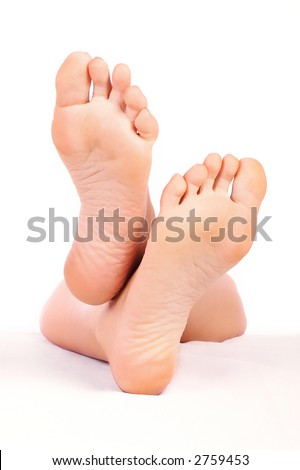 Beautiful woman feet. Isolated over white background - stock photo