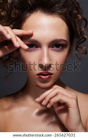 Beautiful woman framing her face with hands and smiling - stock photo