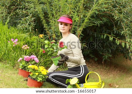 Beautiful woman gardener - stock photo