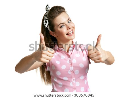 Beautiful woman gesturing thumbs up / photo of young cheerful brunette woman over white background, positive emotions - stock photo