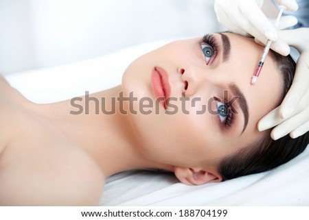 Beautiful Woman gets Injection In Her Face. Cosmetic Surgery - stock photo