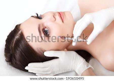 Beautiful woman gets injections. Cosmetology. Beauty Face - stock photo