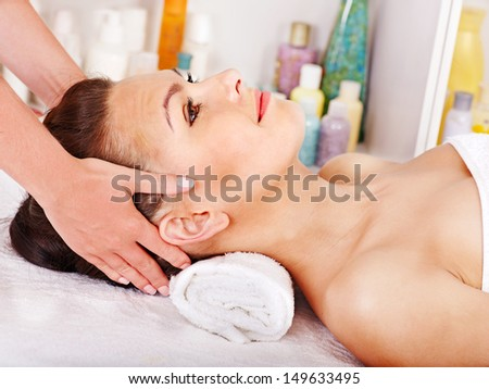 Beautiful woman getting head massage.