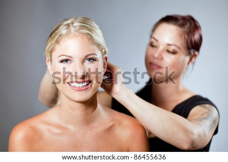 Beautiful woman getting her hair done - stock photo