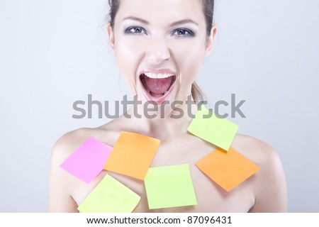 beautiful woman getting mad covered with sticky notes