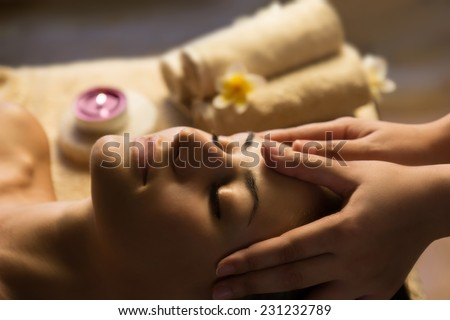 Beautiful woman getting spa treatment. Facial massage - stock photo