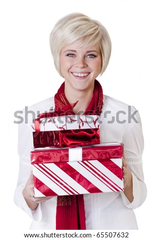 Beautiful Woman giving christmas presents - stock photo