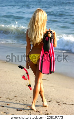 Beautiful Woman going Snorkeling in San Clemente - stock photo