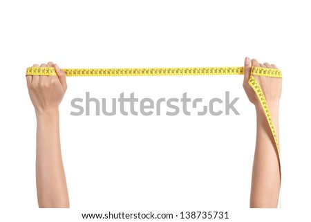 Beautiful woman hand stretching a measure tape on a white isolated background - stock photo