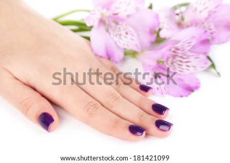 Beautiful woman hand with flowers isolated on white