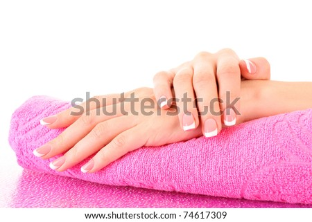 Beautiful woman hand with french manicure on pink background