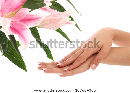 Beautiful woman hands and lily flower over white background - stock photo