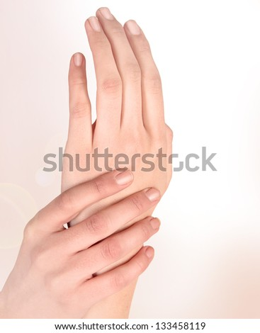 Beautiful woman hands isolated on a white background